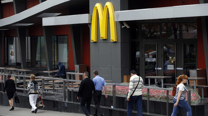 People walk past a closed McDonald's restaurant, one of four temporarily closed by the state food safety watchdog, in Moscow (Reuters/Maxim Zmeyev)