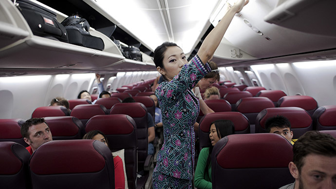 A Malaysia Airlines flight attendant (C) prepares for take off (AFP Photo / Nicolas Asfouri)