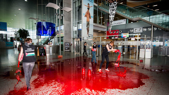 'No weapons for Israel!' Protest group pours fake blood in Belgium airport