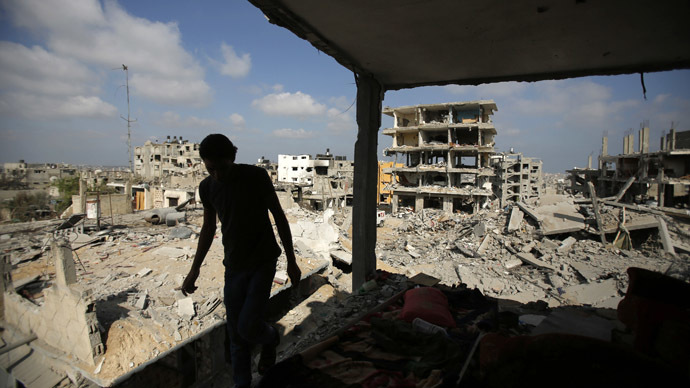 A Palestinian returns to his house, which witnesses said was destroyed in an Israeli offensive, after a ceasefire was declared, in the east of Gaza City August 27, 2014. (Reuters/Suhaib Salem)