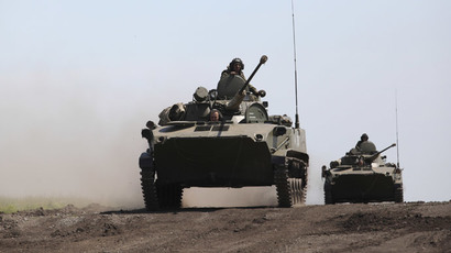 A column of BMD-2 airborne combat vehicles move towards the assembly area of combined forces of the Central Military District and airborne troops at the Chebarkul firing range as part of a sudden operational readiness test.(RIA Novosti / Vladislav Belogrud)