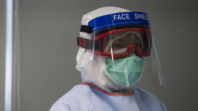 A doctor, wearing protective gear, takes part in a drill with a dummy to demonstrate the procedures of handling a patient afflicted with the Ebola virus, in Hong Kong September 2, 2014. (Reuters/Tyrone Siu)