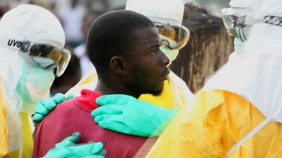Health workers surround an Ebola patient who escaped from quarantine from Monrovia's Elwa hospital, in the centre of Paynesville in this still image taken from a September 1, 2014 video. (Reuters/Reuters TV)