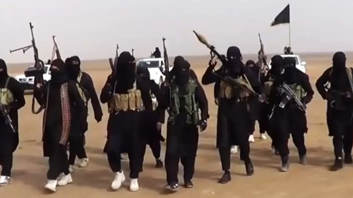 An image grab taken from a propaganda video uploaded on June 11, 2014 by jihadist group the Islamic State of Iraq and the Levant (ISIL) allegedly shows ISIL militants gathering at an undisclosed location in Iraq's Nineveh province. (AFP Photo/ISIL)
