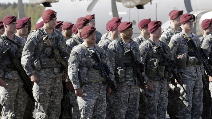 First company-sized contingent of about 150 U.S. paratroopers from the U.S. Army's 173rd Infantry Brigade Combat Team based in Italy attend a welcome ceremony in the airport in Riga April 24, 2014.  (Reuters/Ints Kalnins)
