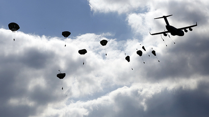 "Troops from the U.S. Army's 173rd Infantry Brigade Combat Team parachute from a Boeing C-17 Globemaster III during a NATO-led exercise ""Orzel Alert"" held together with Canada's 3rd Battalion and Princess Patricia's Light Infantry, and Poland's 6th Airborne Brigade in Bledowska Desert in Chechlo, near Olkusz, south Poland May 5, 2014 (Reuters / Kacper Pempel)"