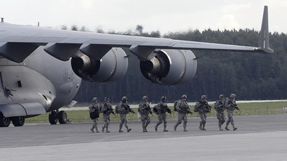 "U.S. 173 airborne brigade soldiers leave a C-130 aircraft during the ""Steadfast Javelin II"" military exercise in the Lielvarde air base, September 6, 2014. (Reuters / Ints Kalnins)"