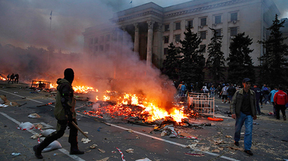 A protester walks past a burning Anti-goverment tent camp near the trade union building in Odessa May 2, 2014 (Reuters / Yevgeny Volokin)