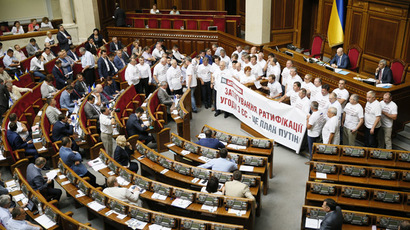 Members of the Batkivshchyna (Fatherland) political party hold a banner during a session of the parliament in Kiev August 14, 2014. (Reuters/Gleb Garanich)