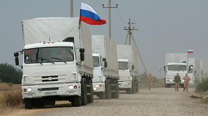A Russian convoy of trucks carrying humanitarian aid for Ukraine are parked by the side of a road near Kamensk-Shakhtinsky, Rostov Region, September 12, 2014 (Reuters / Alexey Koverznev)