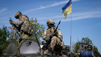 Members of the military special forces sit on an armoured vehicle near Kramatorsk September 4, 2014.(Reuters / Gleb Garanich)