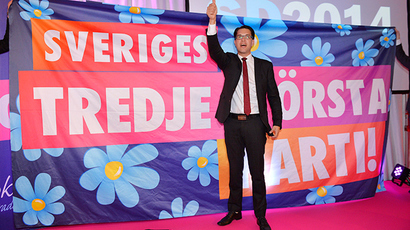 "Party leader Jimmie Akesson gives the thumbs up in front of a poster that reads, ""Sweden's third largest party!"" at the election night party of the Sweden Democrats in Stockholm, September 14, 2014 (Reuters / Anders Wiklund)"