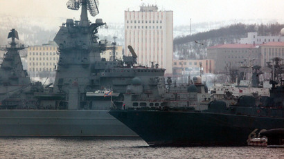 "Heavy nuclear missile cruiser ""Pyotr Veliky"" (Peter the Great) and the large anti-submarine ship (BPK) ""Admiral Levchenko"" (left-right) stand at dock.(RIA Novosti / Mikhail Fomichev)"
