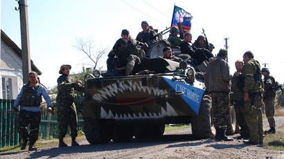 Fighters of the Donetsk People's Republic militia in the village of Yasenevka. (RIA Novosti/Gennady Dubovoy)