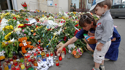 Local residents light a candle for victims of Malaysia Airlines Flight MH17, outside the Dutch embassy in Kiev  (Reuters)