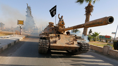 Militant Islamist fighters on a tank take part in a military parade along the streets of northern Raqqa province (Reuters / Stringer)