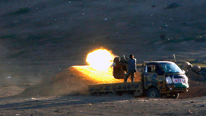 Fighters fire a machinegun against Islamic State positions from a location west of Kobani during fighting on November 4, 2014.(Reuters / Yannis Behrakis )