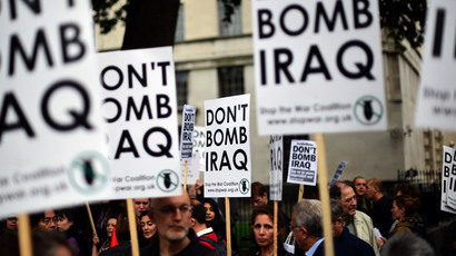 Protester take part in a Stop the War demonstration opposite Downing Street in central London on September 25, 2014.(AFP Photo / Carl Court)