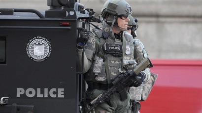 SWAT officers patrol the Copley Square area after explosions near the finish line of the Boston Marathon in Boston, Massachusetts April 15, 2013.  (Reuters/Neal Hamberg)