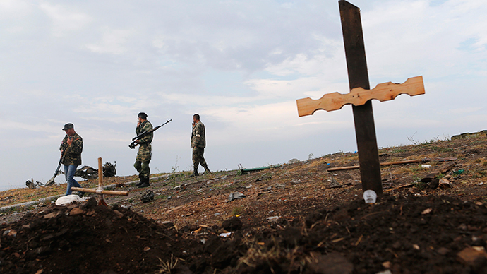 An unmarked grave at Savur-Mohyla, a hill east of the city of Donetsk (Reuters / Maxim Shemetov)
