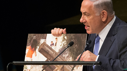 Israel's Prime Minister Benjamin Netanyahu talks about a photograph as he addresses the 69th United Nations General Assembly at the U.N. headquarters in New York September 29, 2014. (Reuters / Brendan McDermid)