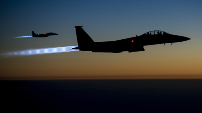A pair of U.S. Air Force F-15E Strike Eagles fly over northern Iraq after conducting airstrikes in Syria, in this U.S. Air Force handout photo taken early in the morning of September 23, 2014. (Reuters/U.S. Air Force/Senior Airman Matthew)