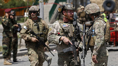 U.S. troops keep watch at the site of a suicide car bomb attack in Kabul August 10, 2014. (Reuters/Omar Sobhani)