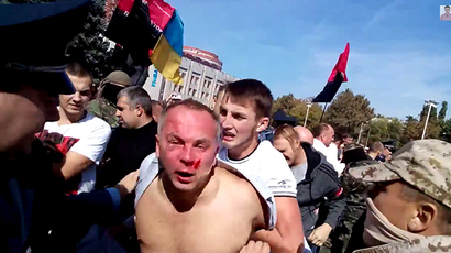 'Almost lynching': Radicals attack Ukrainian officials, throw into trash bins