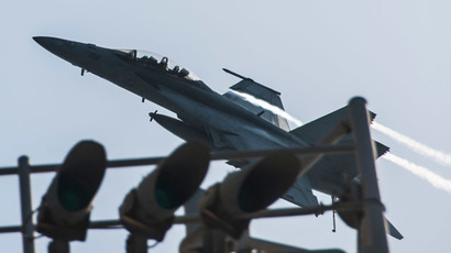 An F/A-18F Super Hornet attached to the Fighting Black Lions of Strike Fighter Squadron (VFA) 213 flies over the aircraft carrier USS George H.W. Bush (CVN 77) after conducting strike missions against the Islamic State of Iraq and the Levant (Reuters/ Mass Communication Specialist 3rd Class Brian Stephens / U.S. Navy / Handout via Reuters)