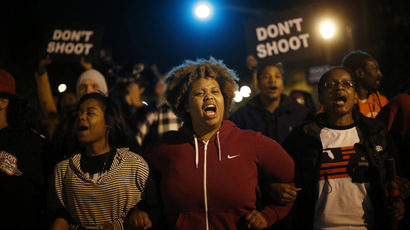 'Justice for everyone!' Thousands stand up against police brutality in Ferguson, St. Louis