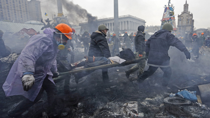 Anti-government protesters carry an injured man on a stretcher after clashes with riot police in the Independence Square in Kiev February 20, 2014. (Reuters / Yannis Behrakis)