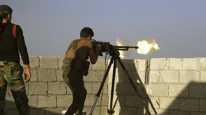A rebel fighter fires his weapon during what the rebels said were clashes with Islamic State fighters at the frontline in Aleppo's northern countryside October 10, 2014. (Reuters / Jalal Al-Mamo)