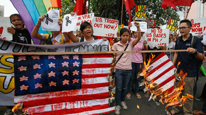 Students burn a mock US flag during a protest rally against the killing of a 26-year-old Filipino transgender Jennifer Laude, outside the U.S. embassy in Manila October 14, 2014.(Reuters / Erik De Castro)