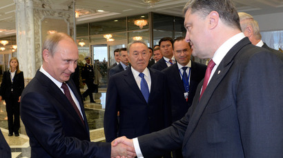 Russian President Vladimir Putin (L) shakes hands with his Ukrainian counterpart Petro Poroshenko, as Kazakh President Nursultan Nazarbayev (C) stands nearby, in Minsk August 26, 2014.(Reuters / Sergei Bondarenko)