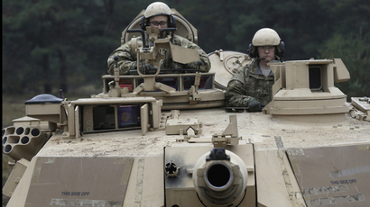 U.S. soldiers deployed in Latvia sit in an Abrams tank during a drill at Adazi military base October 14, 2014. (Reuters/Ints Kalnins)