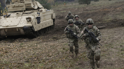 U.S. soldiers deployed in Latvia perform during a drill at Adazi military base October 14, 2014. (Reuters / Ints Kalnins)
