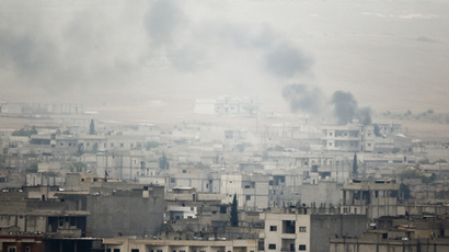 Smoke rises from the Syrian town of Kobani, October 17, 2014. (Reuters/Kai Pfaffenbach)
