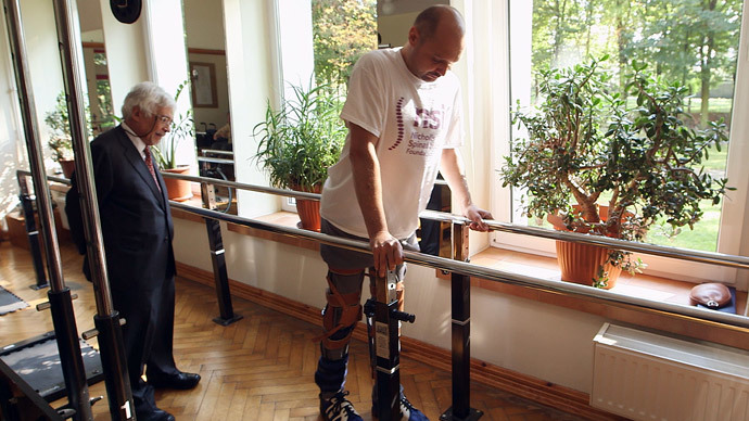 Paralyzed man walks again thanks to UK-funded tech