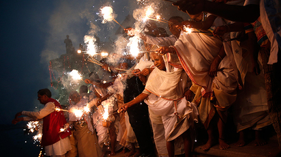 Widows, who have been abandoned by their families, light sparklers after offering prayers on the banks of the river Yamuna as part of Diwali celebrations organised by non-governmental organisation Sulabh International in Vrindavan, in the northern Indian state of Uttar Pradesh October 21, 2014 (Reuters / Ahmad Masood)