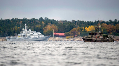 "The Swedish minesweeper HMS Kullen and a guard boat are seen in the search for suspected ""foreign underwater activity"" at Namdo Bay, Stockholm (Reuters / Fredrik Sandberg / TT News Agency)"