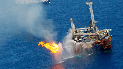 A drilling platform near the Transocean Discoverer Enterprise drillship burns off gas collected at the BP Deepwater Horizon oil spill on June 25, 2010 in the Gulf of Mexico off the coast of Louisiana. (Chris Graythen / Getty Images / AFP)