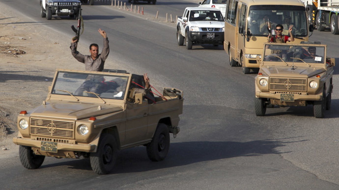 Syria blasts Turkey for allowing Iraqi Kurdish fighters safe passage to Kobani