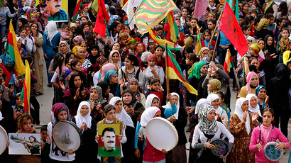 Protesters carry pictures of Abdullah Ocalan, the jailed leader of the Kurdistan Workers' Party (PKK), during a demonstration in support of Kurdish fighters and the besieged citizens of the Syrian town of Kobani and against the Islamic State, in Aleppo's Kurdish neighbourhood of Sheikh Maksoud November 1, 2014 (Reuters / Hosam Katan)