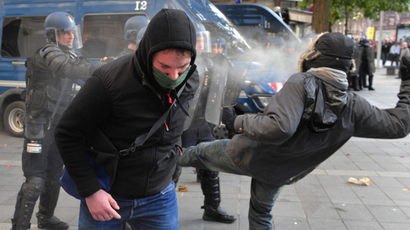 Riot police spray tear gas onto a protester's face on November 1, 2014 in Nantes, western France, during a demonstration against police violence and in memory of Remi Fraisse, an environmental activist killed in clashes between security forces and protesters of the Sivens dam project. (AFP Photo / Georges Gobet)
