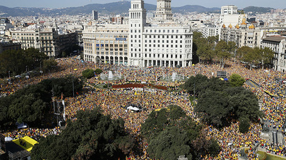 Catalan pro-independence demonstrators gather at Catalunya square during a rally in Barcelona October 19, 2014. (Reuters/Albert Gea)