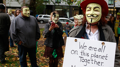 "Members and supporters of the Anonymous movement wear Guy Fawkes masks as they demonstrate as part of the ""Million Mask March"" in Portland, Oregon November 5, 2014. (Reuters / Steve Dipaola)"