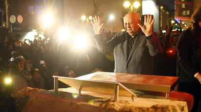 Former Soviet President Mikhail Gorbachev^makes an impression with his hands in cement as he visits the former Berlin Wall border crossing point Checkpoint Charlie, in Berlin November 7, 2014.     (Reuters/Hannibal Hanschke)