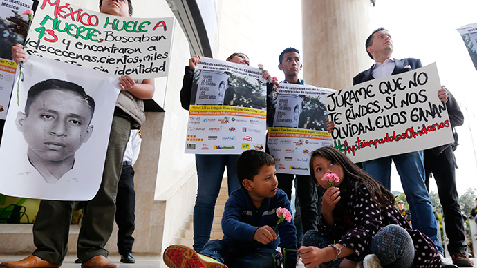 Students holding placards take part in a protest in support of the 43 missing students of the Ayotzinapa teachers' training college Raul Isidro Burgos, outside the Mexican Embassy in Bogota November 7, 2014 (Reuters / John Vizcaino)