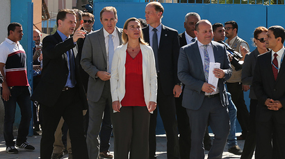 European Union foreign policy chief Federica Mogherini (C) looks on as she visits a UN-run school sheltering Palestinians, whose houses were destroyed during the most recent conflict between Israel and Hamas, in Gaza City November 8, 2014 (Reuters / Mohammed Salem)