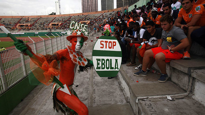 A fan of Ivory coast holds a sign with a message against Ebola during the 2015 African Nations Cup qualifying soccer match between Ivory Coast and Sierra Leone at the Felix Houphouet Boigny stadium in Abidjan September 6, 2014.  (Reuters/Luc Gnago)